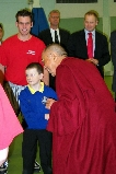 Mike Evans '05 (red shirt) met with the Dalai Lama (right) in Belfast.