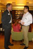 President of the Hamilton DC Alumni Association, Paddy McGuire '81, talks with Renxiang Wei '15.
