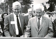 Walter Beinecke (right) and former President Martin Carovano cut the