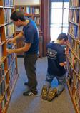HAVOC volunteers clean the stacks at the Kirkland Town Library.