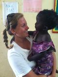 Hillary Kolodner '14 with a Senegalese child at the community center.