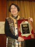 Hong Gang Jin receives the NCOLCTL 2013 Walton Award