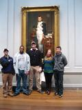 Kevin Prior, Cam Waugh, Knute Gailor, Amy Soenksen and Dylan Wulderk stand by David's portrait of Napoleon near the rotunda of the National Gallery of Art.