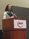 Head Women's Volleyball Coach Erin Glaser presents at the AVCA Conference.