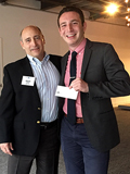 Investor Brian Shine with Shark Tank Sam Matlick '17 holding winning check