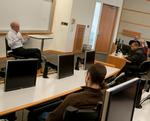 Henry Bedford '76 discussed international finance with Balkan's class on march 2
