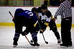 Mike Gately '10 takes a faceoff