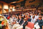 Students and faculty listen to President Joan Stewart's welcome in Wellin Hall.