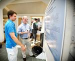 Dan Mermelsten '14 talks to his father, Jeffrey, about his summer research project.