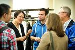 Professor Hong Gang Jin  talks with Kevin Rovelli '15 and his parents, Dan Rovelli and Ana Paula Machado during a Family Weekend Tea.
