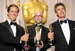 Nat Faxon '97 (left), with fellow writers Jim Rash and Alexander Payne.