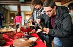 Jason Mariasis '12 helps himself to some chocolate mousse and cake.