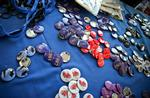 Buttons representing the visiting reunion classes are displayed on a table at the registration desk.