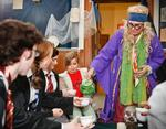 Professor Trelawney (Thea Spittle '12, right) pours tea for Chloe Eldevik-Lacotera, 8, center, and students from Hogwarts.