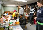 Standing, l-r, Nina Byers' 16, Andrew Gibeley '16, T.C. Topp '16, Jane Barnard '13 and kneeling, Leonard Collins '15, volunteered at the Country Pantry.