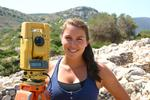 Caroline Morgan '13 with an EDM machine, also known as the Total Station, that is used to record wall measurements.