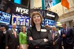 President Joan Stewart on the floor of the New York Stock Exchange.