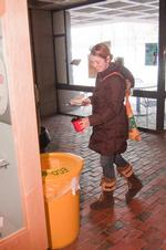 Claire Browne '11 recycles her mug in the in bin behind Cafe Opus