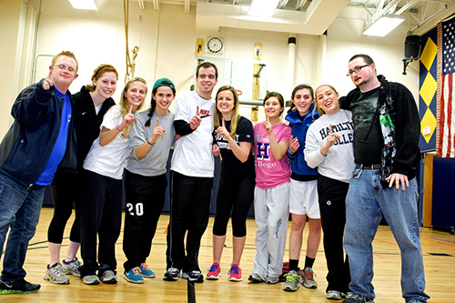 Members of the women's socccer team pose  with some Special Olympics athletes after their basketball game.