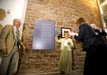 Edward and Virginia Taylor unveil the plaque dedicated to them in the Taylor Science Center lobby.
