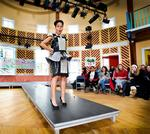 Tiffany Andrade '13 models an outfit designed by Jamie Leiva Cabrera '14, and made out of paper and duct tape.