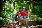 Hannah, 7, and Naomi Gardner-Woods, 8, look at photos in Root Glen. They're the daughters of Ruth Gardner-Woods '99 of New Hampshire.
