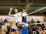Courtney Somerville '16 goes up for a spike during a game against Middlebury in the Field House.
