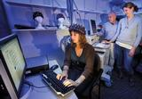 Spencer Gulbronson '12 (seated), Stu Hirshfield and Leanne Hirshfield '02 measure cognitive and emotional brain responses using non-invasive techniques.