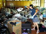 Akritee Shrestha '13 adds to the growing pile of clothing to be donated to the Salvation Army.