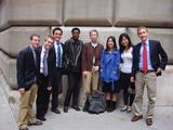 Monetary policy class in front of the Federal Reserve