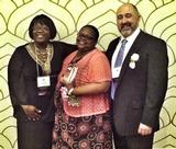 Phyllis Breland '80 with Doris Waiters from the New York State Education Department and William Short, HEOP director at St. Lawrence University, at the TSC awards presentation.