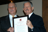 Rand Carter, right, accepts his award from Michael Bosak, president of the Landmark Society of Utica.