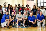 Hamilton athletes and coaches pose for a photo with students from the Citizen Schools of Boston in the Alumni Gym.