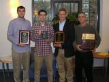 Left to right: Francois Martin '12, Frank Campagnano '12, Bennett Weinerman '12 and Hamilton College men's soccer head coach Perry Nizzi at the presentation of postseason awards on Dec. 15.
