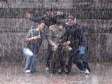 Shaan Gajria, Chris Smith, and Ayush Soni brave a downpour for a photo op with FDR.