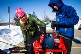 Team Captain McKayla Dunfey '13 and Peter Skaggs '16 put the finishing touches on their skis just before the start of the 20km race.