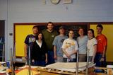 D.C. Hamiltonians pose for a team picture after repainting an elementary school classroom.