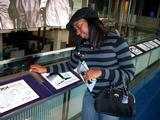 Kenya Lee '10 checks out an exhibit at the Newseum.
