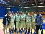 Hamilton men's basketball celebrates its 2011 Tip-Off Tournament Championship.