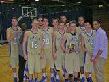 Hamilton men's basketball celebrates its Thanksgiving Tournament championship.