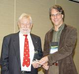 Brent Plate presents Pulitzer Prize-winning poet Gary Snyder with an AAR award.