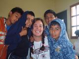 Elizabeth Benjamin '09 with students from Safe Passage