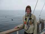 Ashleigh Smythe, on board the Robert C. Seamans, with a rare, short-tailed albatross in the background.