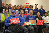 Athletics Department staff and coaches gathered to wrap gifts for the families they adopted through COOP's Holiday Gift Drive.