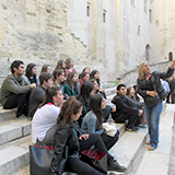 The Hamilton in France program group listens to a guide at the Palais.