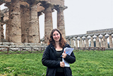Rachel Beamish '16 poses in front of Greek temples while studying abroad in Rome.