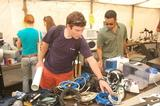 Students browse through electronic items in the Cram & Scram tent