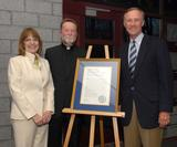 The Rev. John Croghan with president Joan Stewart and Mark Rice '73.
