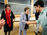 Nobel Laureate Shirin Ebadi greets a student after her classroom discussion.