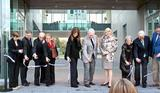 From left, President Joan Hinde Stewart, Professor Sam Pellman, Eugene & Loretta Romano, Linda Johnson, Kevin & Karen Kennedy, Claudia and Jeff Little, and Steve Sadove cut the ribbon of the new Kennedy Center.